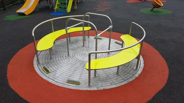 Wheelchair friendly roundabout that can take 2 wheelchairs at the same time while also accommodating other children or friends of those on wheelchairs in the seats!