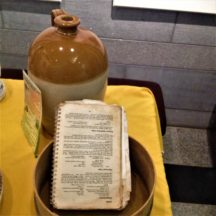 Earthenware pot and old cookery book in Killererin display | Photo: Bernadette Forde