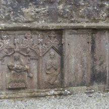 Sculpture on tomb which includes Mary Magdalen in Straide's 13th century Abbey | Photo: https://dpdgay9x1sxad.cloudfront.net/wp-content/uploads/sites/11/2018/06/Sculptures-including-Mary-Magdalen-in-13th-Century-abbey.jpg