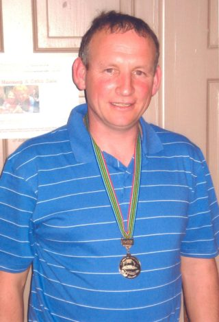 Mike Noone wearing his World Cup Gold medal | Noone family, Garra