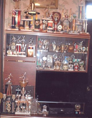 Some of the medals and trophies won by Mickey Kelly, Coolreagh, during his lifetime. | Killererin - A Parish History