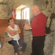 Mary Clery listing intently to Jimmy our guide at The Forge Museum | Bernadette Forde