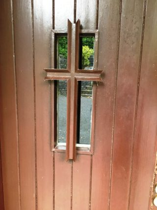 Exterior teak door showing the cross worked into the design | Bernadette Forde