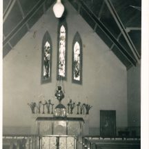 Altar before the changes made under parish priest Fr. Waldron. Note the altar rails which are long gone.