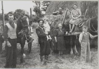 L-r: Ned Mullen, John Maloney (his nephew), Baby John Maloney, Ban Hughes, Daisy Hughes and visitors home for the summer.  Photo taken in 1930s | Photo: Out and About 2004 P. 88
