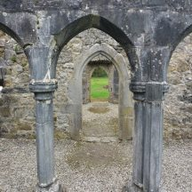 Looking through arch to another arched doorway which leads to another doorway, Portumna   B. Doherty