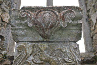 Decorative element on the top section of the tomb. | Christy Cunniffe