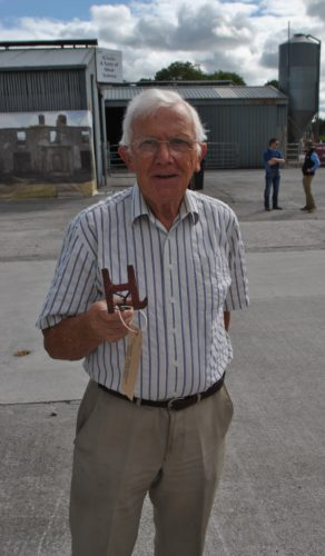 John Holohan displaying the Holohan family branding iron | Christy Cunniffe