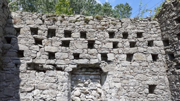 Pigeon holes in upper level of walls showing that there was a lower chamber in the structure. | Christy Cunniffe