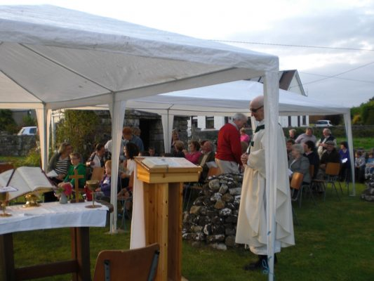 People gathered together at the well, priest in white garment, tent over altar | Abbey & District Heritage Group