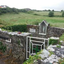 Overlooking holy well showing statue of Holy Mary in wall   B. Doherty 2020