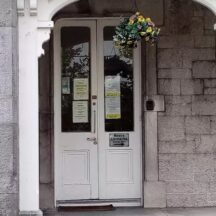 This door is part of the Athenry Railway Hotel in the middle of the 19th century. I have a big interest in 19th century local history. This door has so many stories such as law when Bernard Gunning was apart of a trial known as the Broadstone Murder was an owner of the hotel in 1857: the meetings had by the gentry: revolution 1916-1921: War 1922-23: the building itself was designed by James Mulvany for Rev. James Perry who had landed estate of Cullairbaun and Newford: and the staff of the census 1901 and 1911. The hotel later became a hotel school: VEC and today its the Gretb.   Ronan Killeen