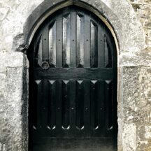 Black stained Solid timber door to six storey tower house at Aughnanure Castle, Oughterard. Within an arched opening   Antoinette Lydon