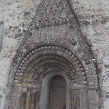 Romanesque doorway of seven orders, Clonfert Cathedral, splays towards the base, Each column is designed differentlywith zoomorphic and geometric designs. The innermost is a later addition of 15th Century.   B. Doherty, 2019