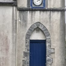 Blue rectangular door within and older stone arched door opening.   Antoinette Lydon