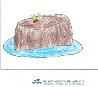 Christmas pudding on a blue plate with holly on top | Áine Doherty Maher