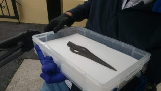 Bronze Age Spearhead is in a white protective box to enable it to be transported to John Hynes at Mountbellew Nursing Home | M. Kilgannon 2021