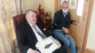 John Hynes holding the Moyarwood Spearhead, with Michéal Kilgannon looking on | B. Doherty 2021