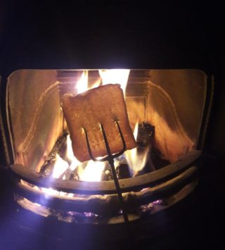 Toasting bread on an open fire | Moycullen Historical Society