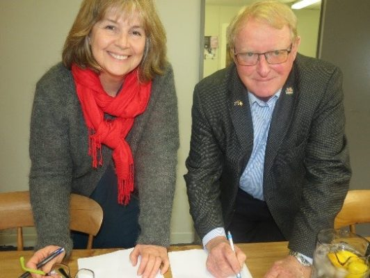 Peter Burke signs contract with Publisher Mary McCallum of The Cuba Press   Peter Burke