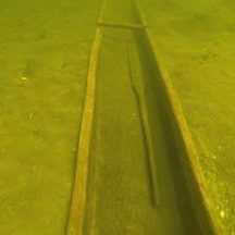 Lee's Island Log boat with steering oar in situ under the waters of Lough Corrib | Photo Credit:  Karl Brady