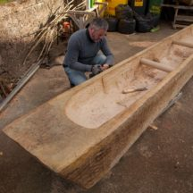 Mark Griffiths works on the replica Lee's Island Log boat | Photo Credit:  Brian MacDomhnaill
