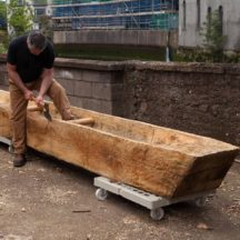Mark Griffiths works on replica Lee's Island Log boat | Photo Credit:  Brian MacDomhnaill