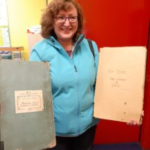 Imelda Cribbin from Melbourne visits Tooreeney School Moycullen and views her mother and grandfather's entries in the school registers | Moycullen Heritage