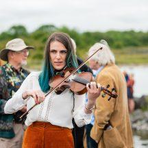 Musician Ciara Finan of Corofin at the launch of the replica Lee's Island 5 Log Boat | MyOptix