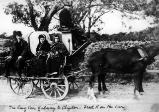 The Galway to Clifden Bianconi Long Car.  Seated on the car is Frederick Francis 'Fred' Kilkelly of Drimcong House (brother of Charles Randolph Kilkelly).  As Fred was born in 1862 and looks in his 20s or 30s in this photo, we presume therefore it dates to the late 1880s or early 1890s.  | Private Kilkelly Family Papers