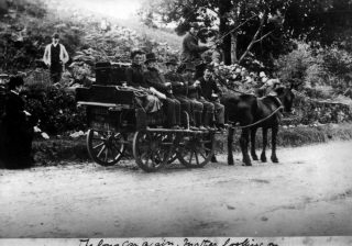 Photo taken by Charles Randolph Kilkelly of the Bianconi Long Car at Drimcong Moycullen.  He includes in his caption under that his mother looks on - this would have been Louisa Isabel Kilkelly (nee Routh).  Note the lettering on the rear of the long car - K O'Brien 978 - K O'Brien was Bianconi's agent, and when Bianconi  retired in 1866 O'Brien purchased the Galway to Clifden operation and kept it running until the Galway to Clifden railway opened in 1895.  | Private Kilkelly Family Papers