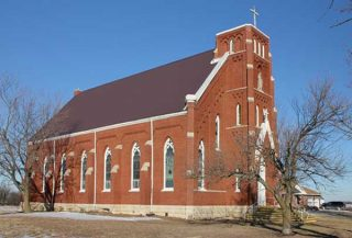 St. Bridget's Church, notable for its unfinished steeple.   | Photo Courtesy of Legendsofkansas.com