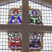 St Brigid is depicted on the bottom right quadrant of the west facing window at The Church of the Immaculate Conception Moycullen.  | Photo Moycullen Heritage