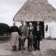 Circa 1940 - Malachy & Mary Bohan and Family.  Car house in the background is still the same and in use today. | Photo:  Mary Croke