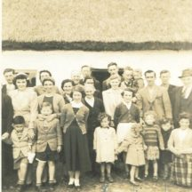 Bridget Hanley + Michael Connell with their two sons returning to New York after a visit to their home place in Clooniff.  Back Row (L-R): Richard Mulkerrins, Celia Hanley, Padraic Faherty, John Hanley, Sean Connell, John Honohoe (holding his son Jimmy), John Lydon. Middle Row (L-R): Bridget Connell (née Hanley), Catherine Hurney, Mary Bohan, Sarah Hanley, May O'Donohoe, Colm O'Donohoe, Matt Faherty Front Row (L-R): John Connell (child), Billy Connell, Bridie Lydon, Mary Lydon (née Lardner), Mary O'Donohoe (child) , Ann Bohan, Loretto O'Donohoe (child), Jean Donohoe (John Donohoe's daughter), Delia O'Donohoe (child), Isabella Bohan | Photo:  Delia O'Donohoe