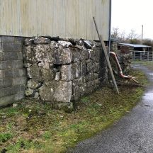 The remaining stone wall of the original Connell homestead is now incorporated into a modern farm outbuilding | Photo Courtesy John Connell