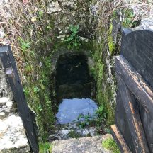 The well at Thumnasragh showing the steps and surrounding wall constructed by William Connell in the 1920s. | Photo Courtesy John Connell