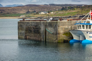 Cleggan Pier. The original pier's stone work, that was built around at a later time, can be seen here. | Roger Harrison
