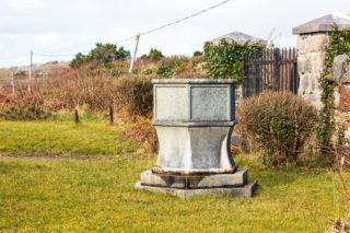 Baptismal font in the grounds of the Errislannan Church of Ireland church | Roger Harrison