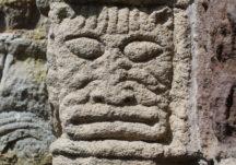 Ornate cat mask carved in sandstone