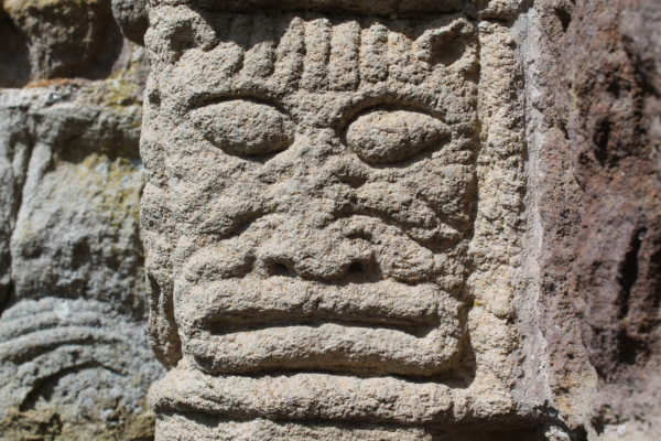 Ornate cat mask carved in sandstone  | Christy Cunniffe