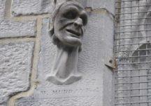 Cartoon-like carved heads