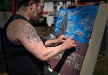 Artist Damien Manning painting