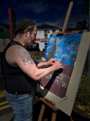 Artist Damien Manning painting St. Joseph's Church and Clifden Courthouse | Thomas O'Sullivan