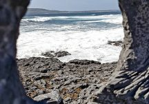 The sea and Inis Meain through the eye of the memorial to those lost at sea