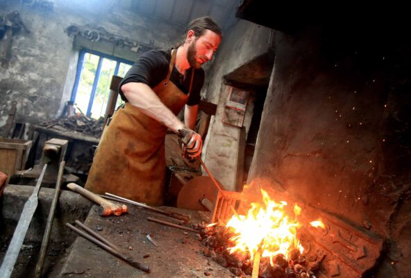 The only sword smith in Ireland, Charlie Gallagher displaying the old way of sword forging at the re-opening of the restored