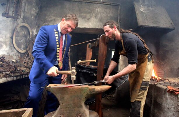 Mayor of county Galway Cllr. Peter Roche forging a sword with the help of the only sword smith in Ireland, Charlie Gallagher at the opening of the restored